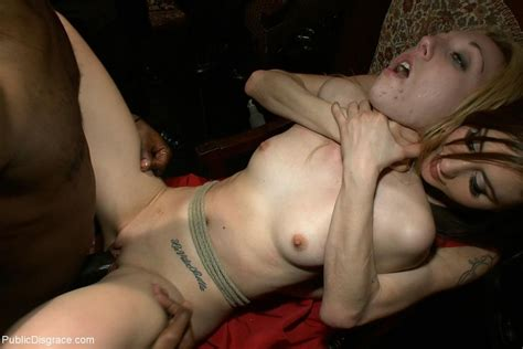 Two Slave Girls Are Tied Dominated And Fucked In Public