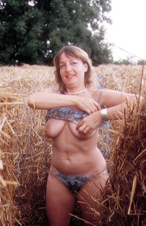 Mature Shows Her Saggy Tits At The Farm