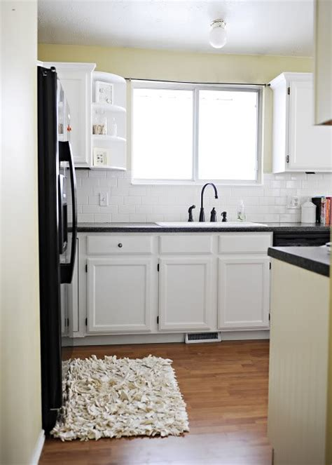 Green Kitchen Cabinets With Black Appliances by White Cabinets Black Appliances Bead Board Green