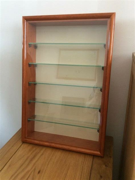small wall mounted wooden display cabinet   glass