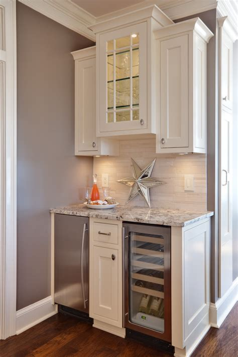 home bar cabinet with refrigerator mini kitchen nook in the basement with mini fridge bar