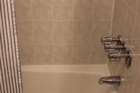 how to re caulk a shower how to recaulk a bathtub apartment therapy