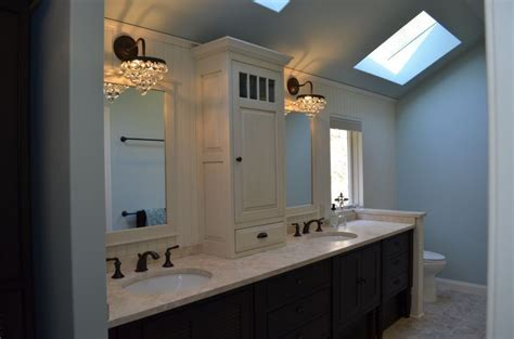 tower  center  bath vanity crystal cabinetry  tone