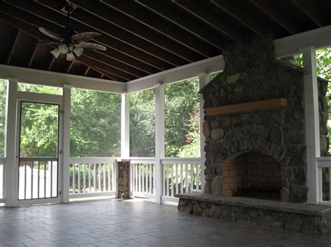 screened covered patio with fireplace living