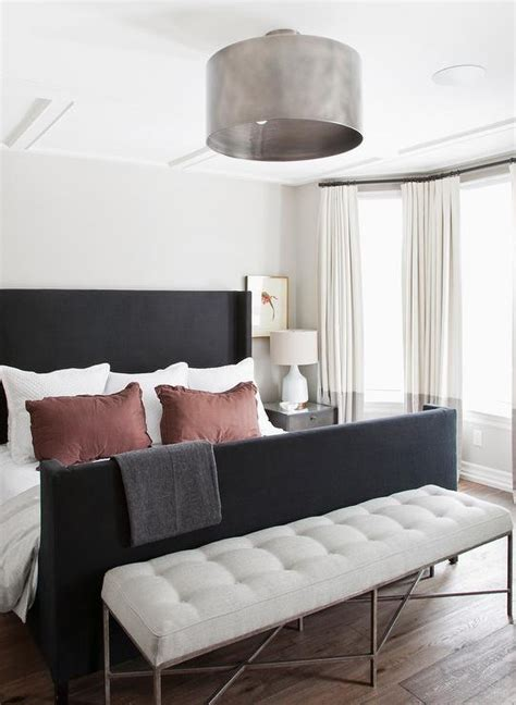 Decorating Ideas For Black Bedroom by Black Wingback Bed With White And Gray Curtains