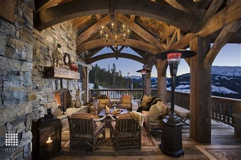 country porch  outdoor chandelier exposed beam