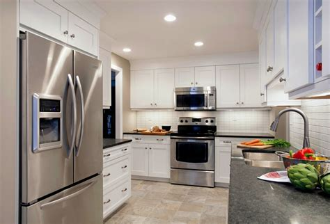 gray kitchen cabinets with stainless steel appliances modern gray granite countertops trendy and