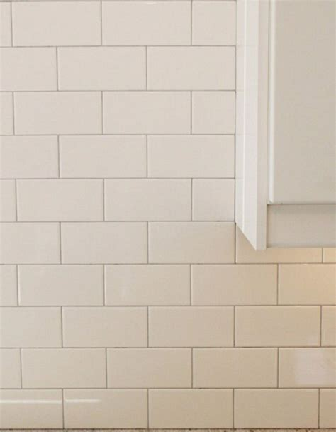 white subway tile with tight light gray grout lines small bath picks