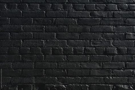 Old brick wall painted black by Kristin Duvall - Wall