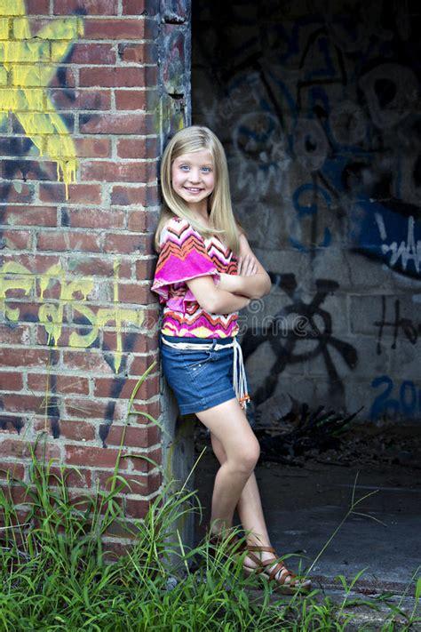 Cute Little Blonde Girl Graffiti Wall Stock Images