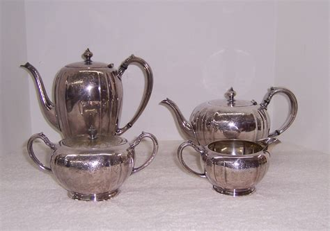 The sugar holder is round and holds up to 12. Community Plate Chelsea Coffee Tea Sugar Creamer Set