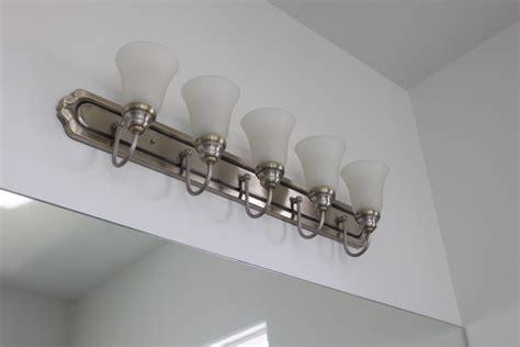 spray painting light fixtures spray painting bathroom light fixture oliveandlove