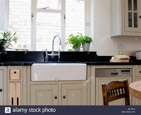belfast sink in modern kitchen belfast sink below window in modern kitchen stock photo 7628