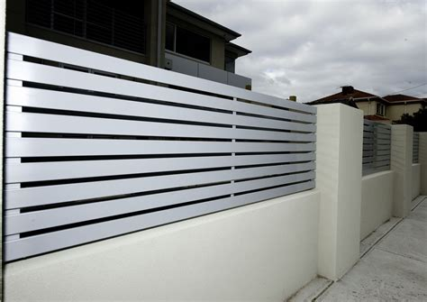 modern fence designs metal archaic design modern fences ideas with white color wall fences and gray color metal bars fences