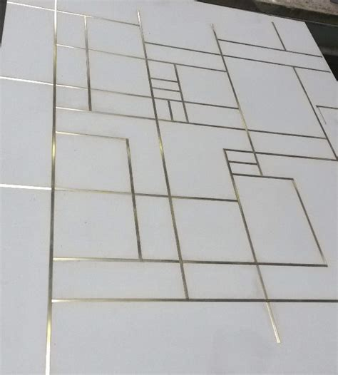 concrete floor tiles with brass inlay the lines