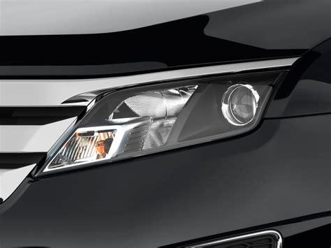 image 2010 ford fusion 4 door sedan sport fwd headlight