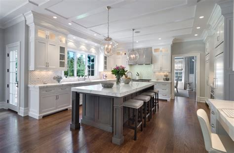 white island kitchen white kitchen cabinets with gray kitchen island transitional kitchen blue water home builders