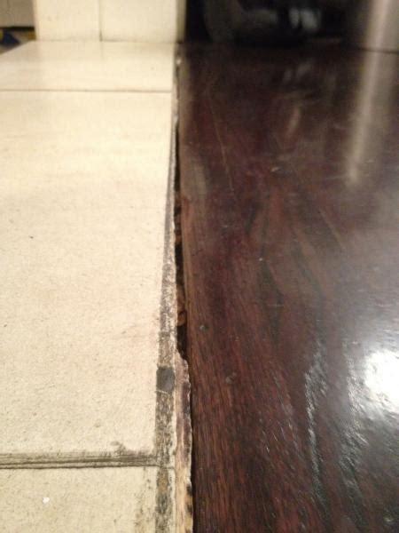 Wood Floor Into Stone transition   DoItYourself.com