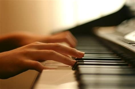 Kar's Kith And Kin Playing A Piano Piece