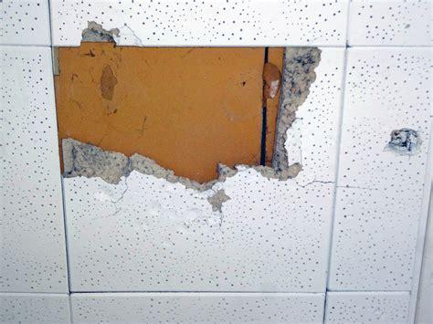 reintalling asbestos ceiling tiles robinson house
