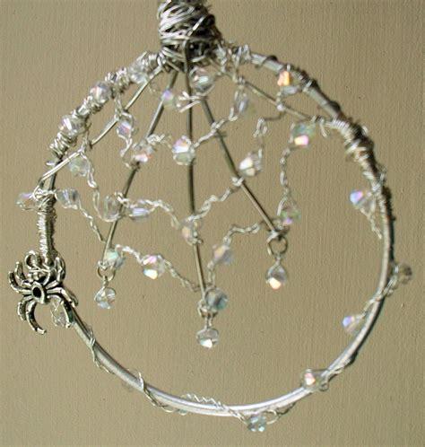 wire work jewelled spiders web     sun