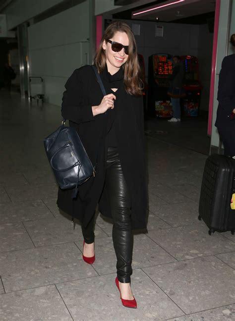 emilia clarke walks  heathrow airport leather