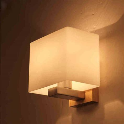 contemporary akili white and timber cube wall light buy