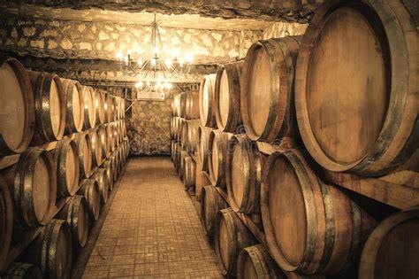 wine cellar  stacked wine barrels stock image