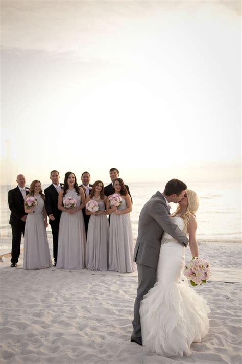 a glamorous silver blush beach wedding beach wedding