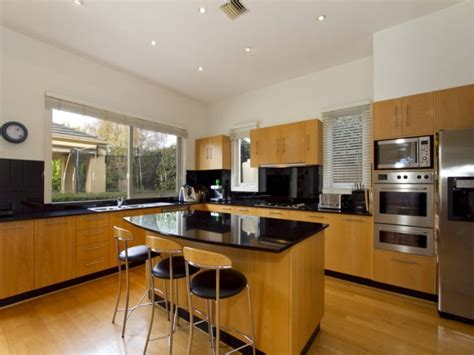 kitchen l shaped island l shaped kitchen with island railing stairs and