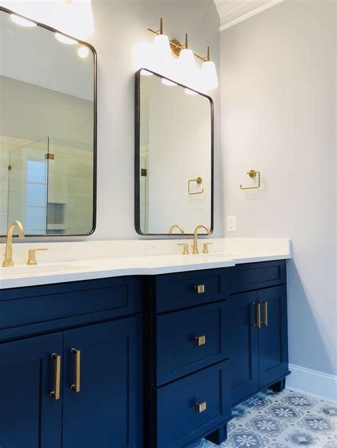 champagne bronze fixtures deep navy blue vanity oil