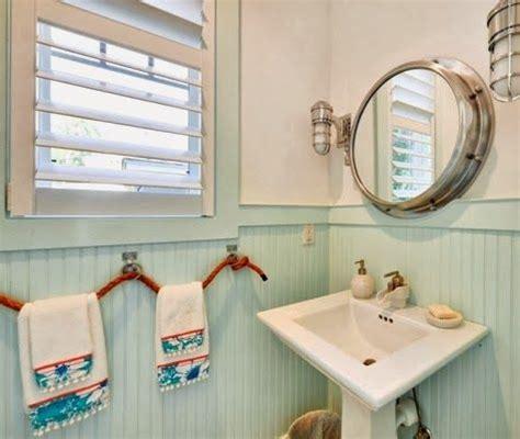 nautical bathroom  porthole mirror  rope towel