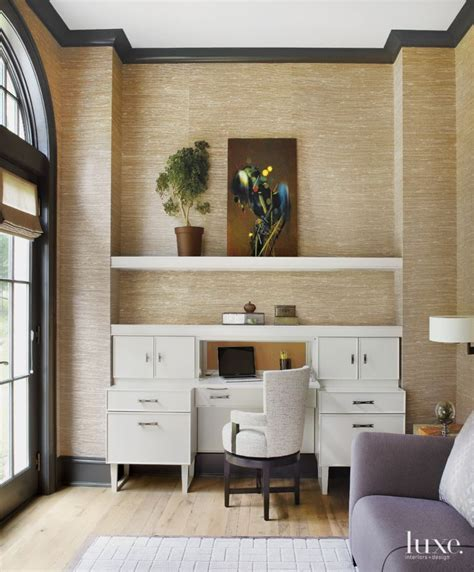 camel colored grasscloth with black crown molding