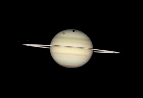 Saturn Moon Transits March 2009 - The Hubble Telescope ...