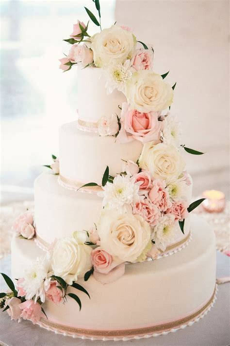 Four Tier Round White And Blush Pink Wedding Cake With