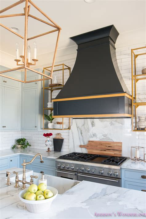 Kitchen Vent Hood Ideas - kitchen white marble calcutta gold open shelves gold black vent hood blue gray cabinets shaker