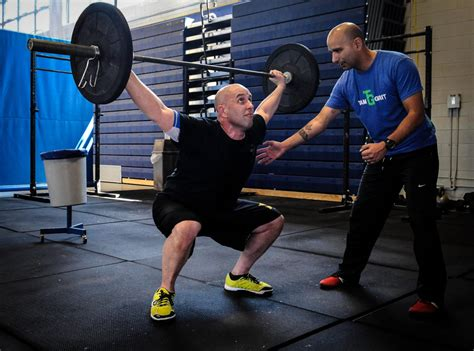 overhead swing the american kettlebell swing why you should never do it
