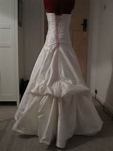 Queen of darts hustle and bustle the hem of the for Wedding dress bustle