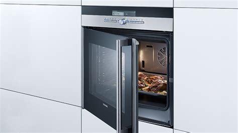 foto de Wanddampkappen: Inbouw oven met draaideur