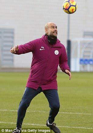 Man City boss Pep Guardiola shows off skills in training ...
