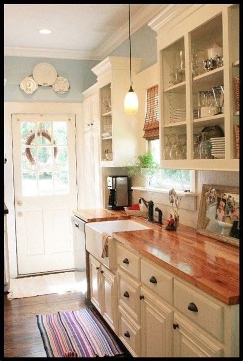 Country Kitchen Sink Ideas by White Cabinets Butcher Block Countertops And Pretty Blue