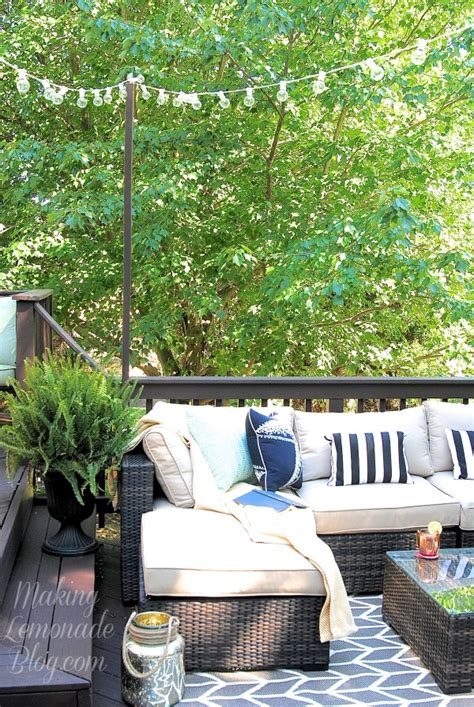 hanging globe lights outdoors how to hang outdoor string lights the deck diaries part