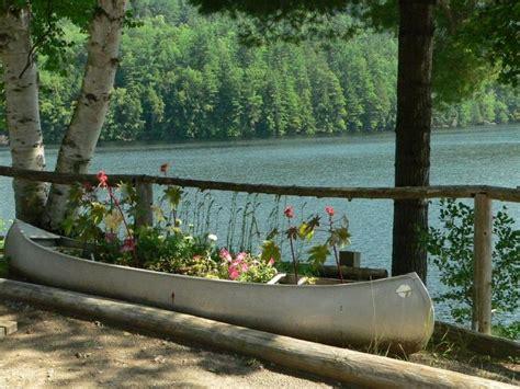 canoe planter  flowers pretty garden