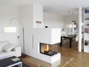 whirlpool im wohnzimmer hersteller okal haus helles wohnzimmer mit dreiseitigem kamin bild 5 schöner wohnen