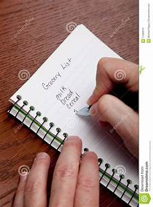 Hands Writing A Shopping List Stock Photo - Image: 11583570