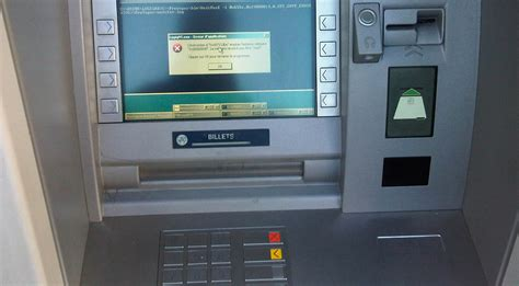 atms running windows xp robbed with infected usb sticks yes most atms still run windows