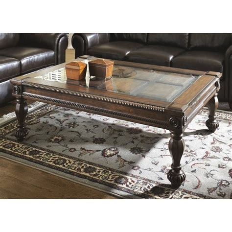 Ashley Mantera Coffee Table With Glass Insert In Dark