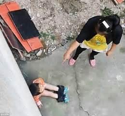 chinese woman whips  kicks  toddler  wetting