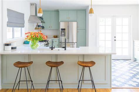 Mint Green Kitchen Peninsula With Brass Mini Pendants