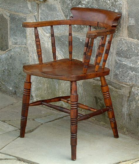 antique low bow back smokers arm chair item